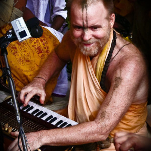 Aindra Prabhu playing harmonium