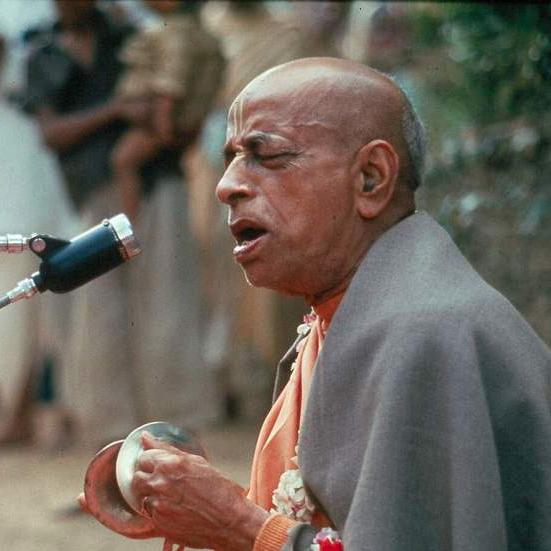 Srila Prabhupada chanting and playing karatalas